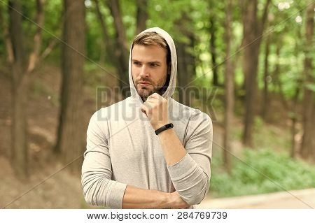 Sportsman Training With Pedometer Gadget. Fitness Tracker Concept. Man Athlete On Pensive Face With