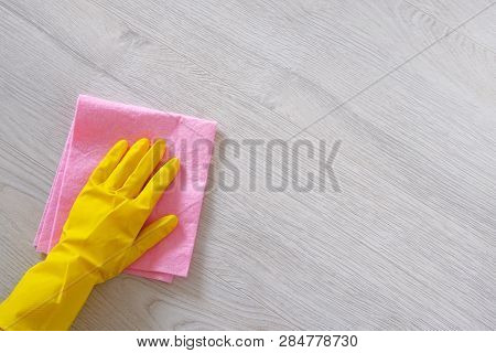 Cleaning Concept In Office, Home. Hand In Yellow Rubber Protective Glove With Micro Fiber Cloth Is C
