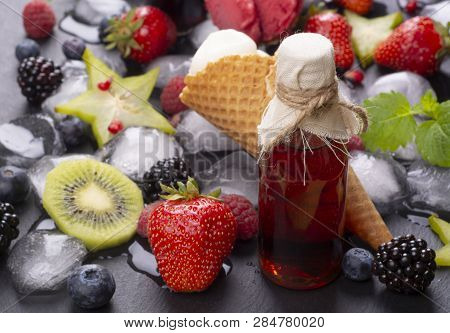 Homemade Fruit Ice Cream And Fresh Fruits With Ice Cubes With Bottle Of Fruit Juice