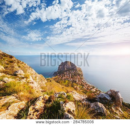 Splendid view of the azure sea on a sunny day. Location place Island Sicilia, Zafferano cape, Palermo city, Italy, Europe. Scenic image of popular vacation destinations. Discover the beauty of earth.