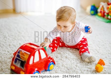 Adorable Cute Beautiful Little Baby Girl Playing With Educational Wooden Toys At Home Or Nursery. He