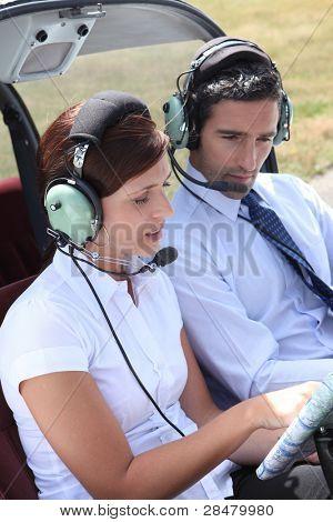 Woman setting a flight plan in an open cockpit