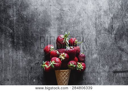 Fresh Strawberries In A White Cup On The Gray Cement Floor A