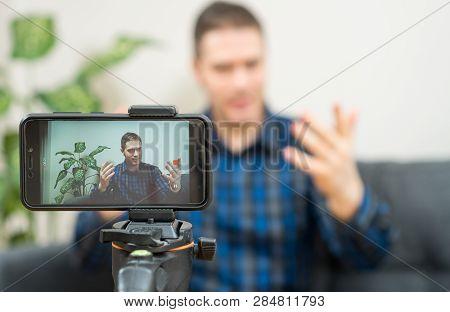 Handsome Man Making Video Blog. Focus On Smartphone.