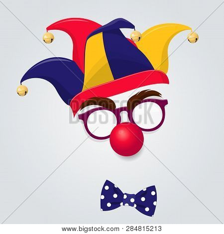 Funny Clown Accessories. Colored Jester Hat With Clown Glasses, Red Nose And Bow Tie On White Backgr