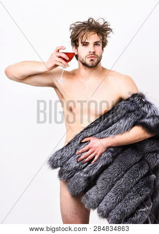 Guy Attractive Rich Posing Fur Coat On Naked Body. Fashion And Pathos. Rich Athlete Enjoy His Life.