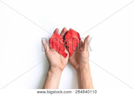 Red Crumpled And Broken Heart Shape Paper On Mam's Hand