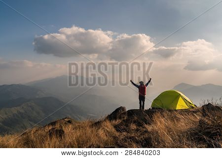 Young Man Traveler With Backpack Camping On Mountain, Adventure Travel Lifestyle Concept
