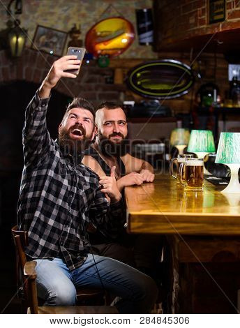 Man In Bar Drinking Beer. Take Selfie Photo To Remember Great Evening In Pub. Online Communication.
