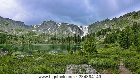 One From Seven Cleanest Mountain Karakol Lakes, Located In The Valley, At The Foot Of The Bagatash P