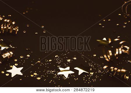 Golden Stylish Decoration On Black Background. Place For Text. Festive Concept.