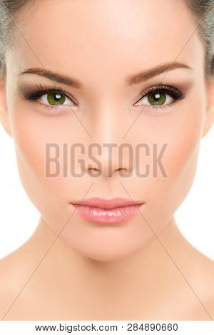 Asian beauty woman. Serious portrait of beautiful mixed race chinese with makeup smokey eyes eyeshadow, mascara, rouge blush on cheeks and lips. Plastic surgery, nose job, facelift. poster