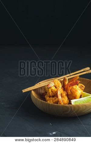 Shrimps Tempura With Lime In Wooden Plate