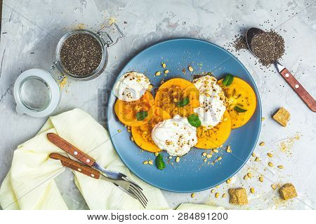 Sliced Persimmon With Yogurt, Chia Seeds, Brown Sugar, Pine Nuts And Fresh Mint