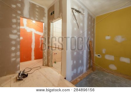 Working Process Of Installing   Plasterboard Or Drywall  For Making Gypsum Walls  In Apartment Is Un