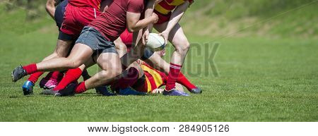 Rugby Players Fight For The Ball On Professional Rugby Stadium