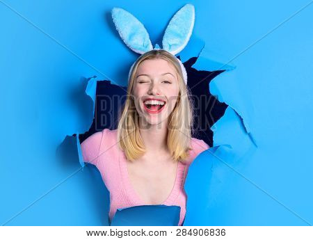 Happy Easter Day. Through Paper. Happy Easter! Smiling Woman With Bunny Ears. Woman Looking Through