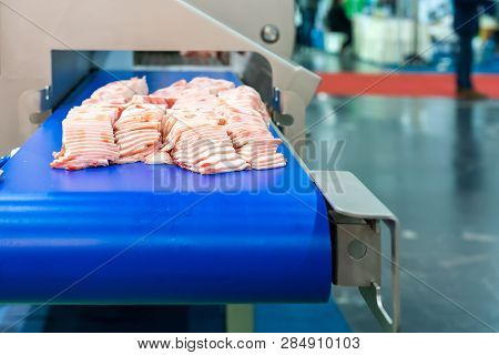 Close Up Pork Or Meat Sliced On Conveyor Of Automatic And Precision Slicer Machine For Industrial Fo