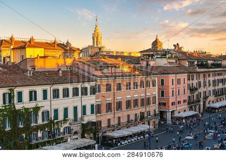 Rome, Italy - September 30 2018: Sunlight From The Setting Sun Highlights The Top Of Buildings In Ca