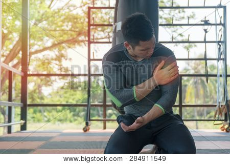 Handsome Fitness Man Has Perfect Body Feeling Pain In His Shoulder During At The Gym, Healthy Man Sh