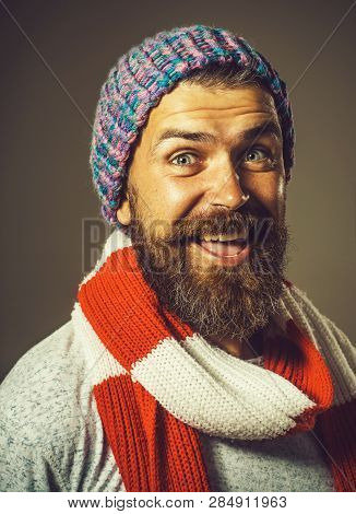 Smiling Bearded Man In Scarf And Hat. Handsome Man Wearing Winter Hat And Scarf. Bearded Man With Sc
