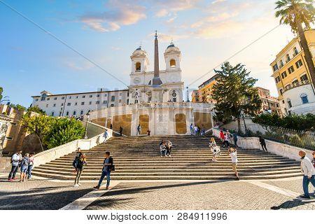 Rome, Italy - September 14 2016: Tourists Walk Up The Spanish Steps Towards The Trinita Dei Monti Ch