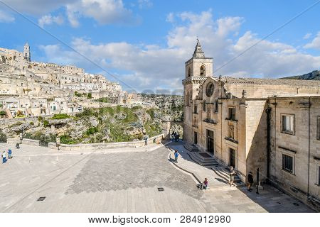 Matera, Italy - September 28 2018: Tourists Enjoy A Summer Day On The Piazza Of The Church Of San Pi