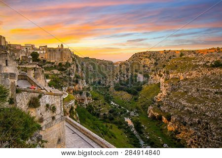 Matera, Italy - September 25 2018: Two Women Enjoy A Sunset Meal On A Terrace In The Ancient City Of