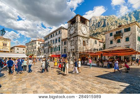 Kotor, Montenegro - September 15 2018: Tourists Sightsee, Dine At Cafes And Shop Under The Clock Tow
