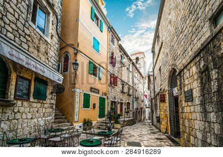 Kotor, Montenegro - September 15 2018: A Narrow Back Street With Cafes, Pubs And Antique Shops In Th