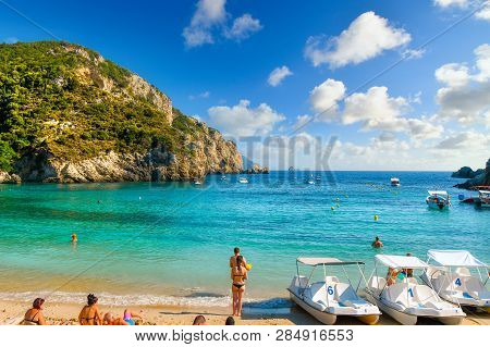 Corfu, Greece - September 16 2018: Tourists Relax In The Clear Waters At The Sandy Palaiokastritsa B