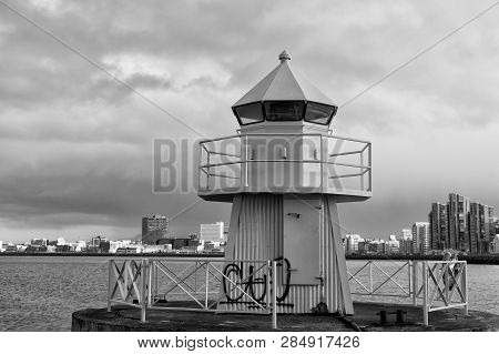 Sea Transportation And Navigation. Lighthouse On Sea Pier In Reykjavik Iceland. Lighthouse Yellow Br