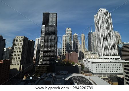 aerial elevated view up above the Chicago River North district looking north from between highrise skyscraper office buildings poster