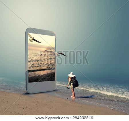 Woman In Swimsuit Walking To A Beach On A Smartphone. The Concept Of Booking Online For Travel.