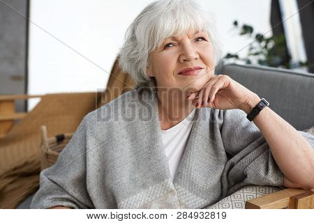 Age, Retirement And Relaxation Concept. Happy Cheerful Mature Retired Woman Looking At Camera With B