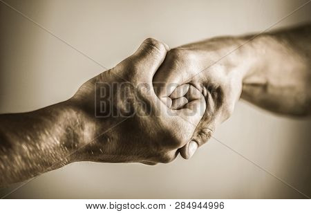 Man Help Hands, Guardianship, Protection. Friendly Handshake, Friends Greeting. Rescue, Helping Hand