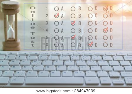 Using White Keyboard On Wood Table To Do Test Examination With Multiple Choice Questions At Home. Ed