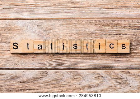 Statistics Word Written On Wood Block. Statistics Text On Wooden Table For Your Desing, Concept