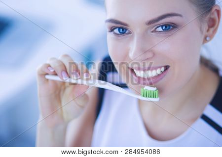 Young Pretty Girl Maintaining Oral Hygiene With Toothbrush.