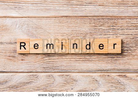 Reminder Word Written On Wood Block. Reminder Text On Wooden Table For Your Desing, Concept