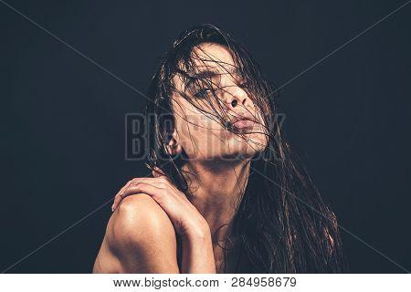 Beautiful Long Hair. Beauty Woman With Luxurious Straight Hair On Dark Background. Beautiful Brunett