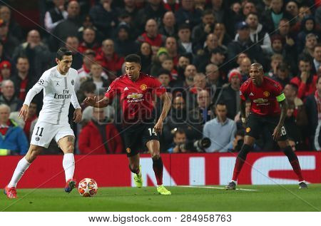 MANCHESTER, ENGLAND - FEBRUARY 12 2019: Angel Di Maria of PSG and Jesse Lingard of Manchester United during the Champions League match between Manchester United and Paris Saint-Germain