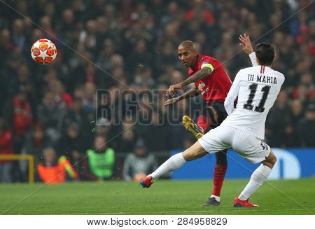 MANCHESTER, ENGLAND - FEBRUARY 12 2019: Ashley Young of Manchester United and Angel Di Maria of PSG during the Champions League match between Manchester United and Paris Saint-Germain