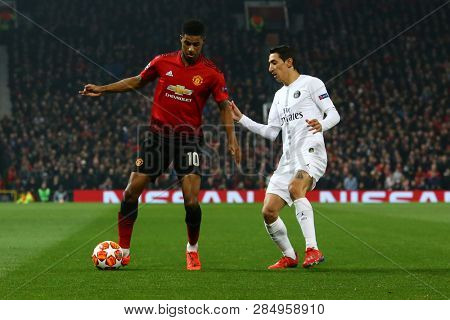 MANCHESTER, ENGLAND - FEBRUARY 12 2019: Marcus Rashford of Manchester United and Angel Di Maria of PSG  during the Champions League match between Manchester United and Paris Saint-Germain