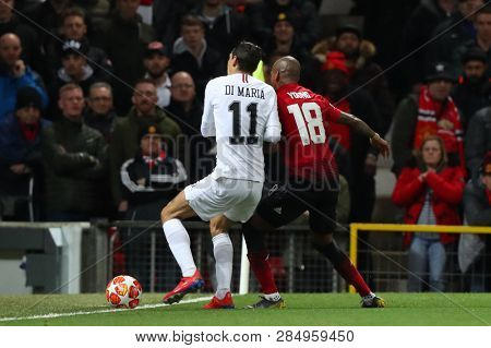 MANCHESTER, ENGLAND - FEBRUARY 12 2019: Ashley Young of Manchester United pushes Angel Di Maria of PSG during the Champions League match between Manchester United and Paris Saint-Germain