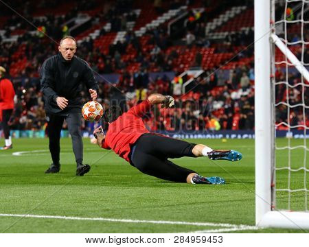 MANCHESTER, ENGLAND - FEBRUARY 12 2019: Gianluigi Buffon of PSG  warms up during the Champions League match between Manchester United and Paris Saint-Germain at Old Trafford Stadium.