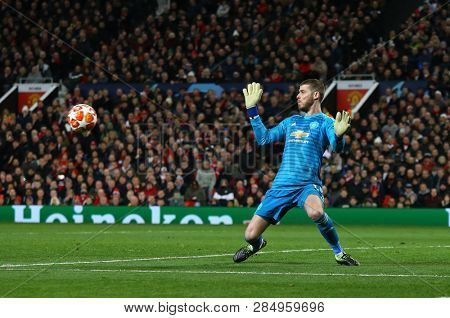 MANCHESTER, ENGLAND - FEBRUARY 12 2019: David De Gea of Manchester United makes a save during the Champions League match between Manchester United and Paris Saint-Germain at Old Trafford Stadium.