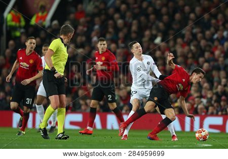 MANCHESTER, ENGLAND - FEBRUARY 12 2019: Julian Draxler of PSG  fouls Ander Herrera of Manchester United during the Champions League match between Manchester United and Paris Saint-Germain