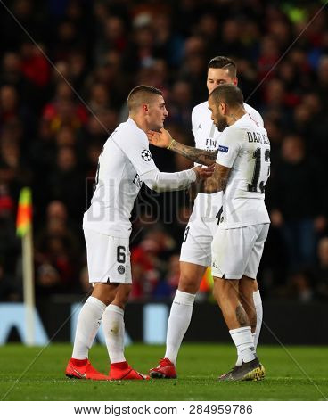 MANCHESTER, ENGLAND - FEBRUARY 12 2019: Dani Alves of PSG berates team mates Marco Verratti and Julian Draxler during the Champions League match between Manchester United and Paris Saint-Germain