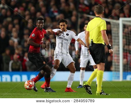 MANCHESTER, ENGLAND - FEBRUARY 12 2019:Paul Pogba of Manchester United and Marquinhos of PSG  during the Champions League match between Manchester United and Paris Saint-Germain at Old Trafford